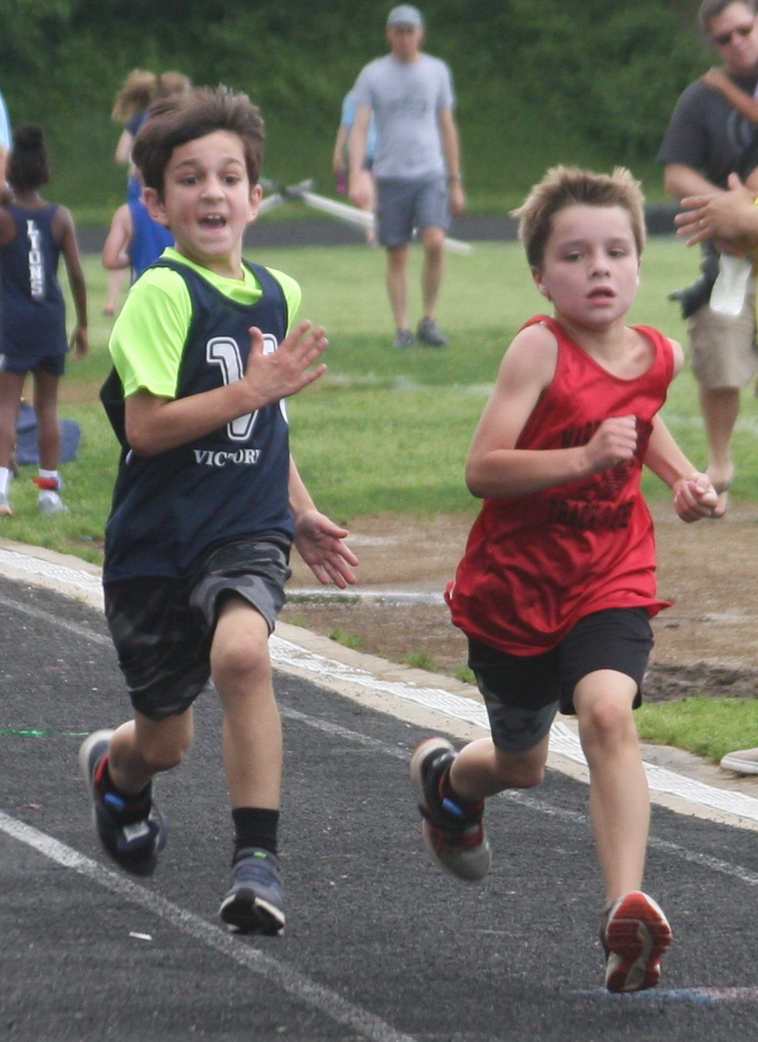 Two athletes sprint to the finish.